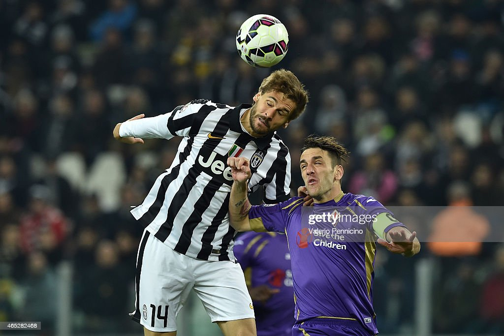 Fernando Lorente (L) of Juventus FC clashes with Gonzalo Rodriguez of ACF Fiorentina during the TIM Cup match between Juventus FC and ACF Fiorentina at Juventus Arena on March 5, 2015 in Turin, Italy.