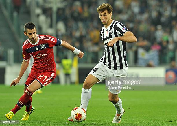 Fernando Lorente of Juventus in action against Maxime Gonalons of Olympique Lyonnais durig the UEFA Europa League quarter final match between...