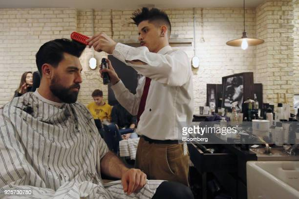 Fernando Madalena, model and lifestyle blogger, has his hair styled during a launch event for House 99, a grooming brand for men created by former...