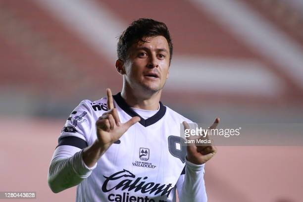 Fernando Madrigal of Queretaro celebrates after scoring the first goal of his team during the 14th round match between Atletico San Luis and...