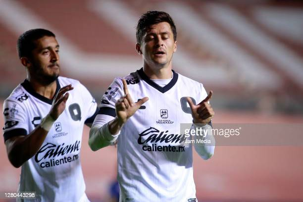 Fernando Madrigal of Queretaro celebrates with Kevin Ramirez after scoring the first goal of his team during the 14th round match between Atletico...