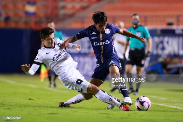 Fernando Madrigal of Queretaro fights for the ball with Pablo Lopez of San Luis during the 14th round match between Atletico San Luis and Queretaro...