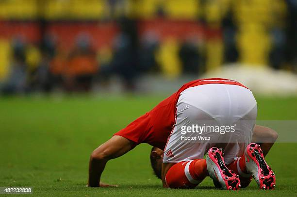 Fernando Marcal of Benfica lies on the grass during a match between America and Benfica as part of the International Champions Cup 2015 at Azteca...