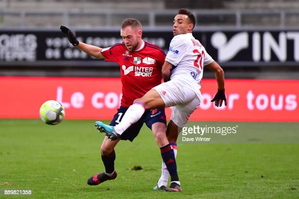 Fernando Marcal of Lyon and Emmanuel Bourgaud of Amiens during the Ligue 1 match between Amiens SC and Olympique Lyonnais at Stade de la Licorne on...