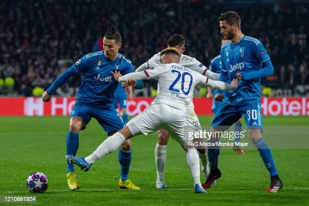 Fernando Marcal of Olympique Lyonnais battles for the ball with Cristiano Ronaldo of Juventus and Rodrigo Bentancur of Juventus during the UEFA...