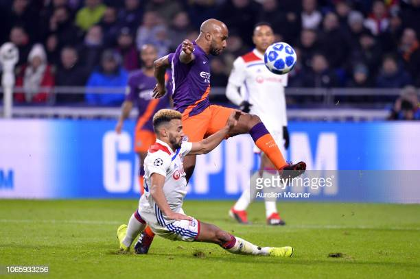 Fernando Marcal of Olympique Lyonnais tackles Fabian Delph of Manchester City during the Group F match of the UEFA Champions League between Olympique...