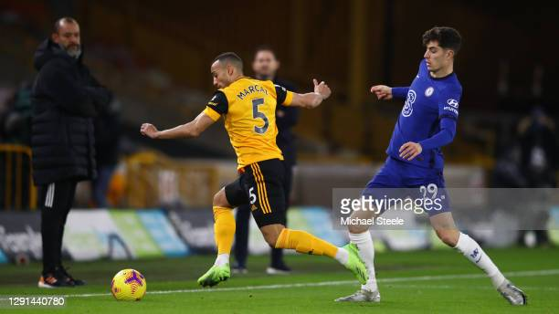 Fernando Marcal of Wolverhampton Wanderers is challenged by Kai Havertz of Chelsea during the Premier League match between Wolverhampton Wanderers...