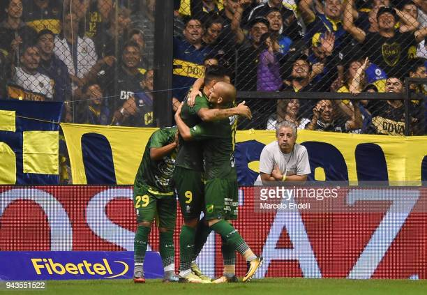 Fernando Marquez of Defensa y Justicia celebrates with Nicolás Fernández Miranda and teammates after scoring the opening goal during a match between...