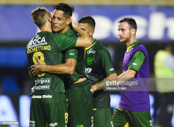 Fernando Marquez of Defensa y Justicia celebrates with teammate Tomas Pochettino after winning a match against Boca Juniors for the first time ever...