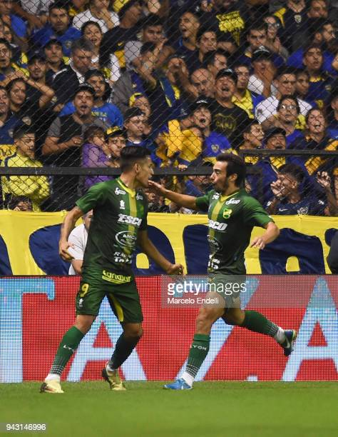 Fernando Marquez of Defensa y Justicia celebrates with teammates after scoring the first goal of his team during a match between Boca Juniors and...
