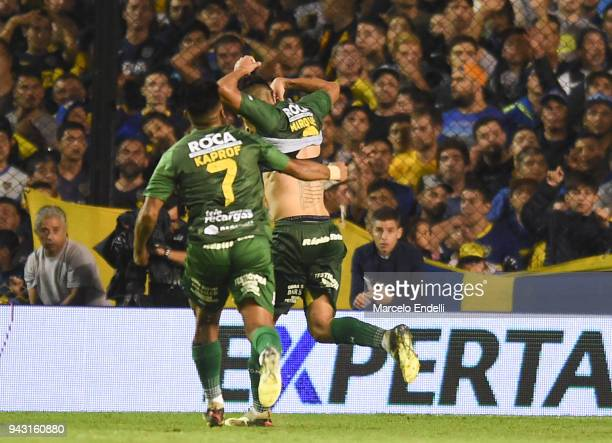 Fernando Marquez of Defensa y Justicia celebrates with teammates after scoring the second goal of his team during a match between Boca Juniors and...