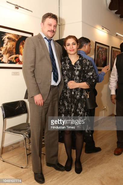 Fernando Martin Abal Baru, Charge d'Affairs of Uruguay in India, with Sara Fayaz during a photography exhibition 'La Virgen de la Candelaria' at the...