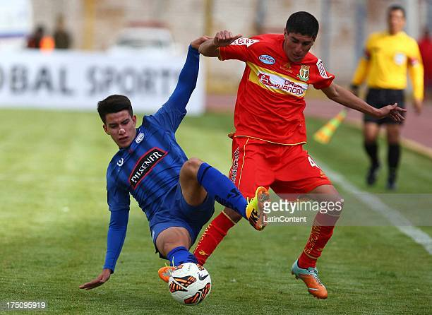 Fernando Masias of Sport Huacayo struggles for the ball with Fernando Gaibor of Emelec during the match between Huancayo and Emelec as part of the...