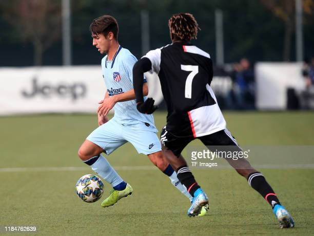 Fernando Medrano of Atletico Madrid U19 and Mamadou Kaly Sene of Juventus Turin U19 battle for the ball during the UEFA Youth League match between...