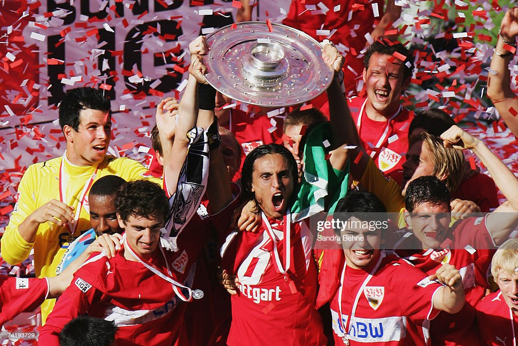 Fernando Meira (C) of VfB Stuttgart celebrates with the trophy winning the German championships after the Bundesliga match against Energie Cottbus at the Gottlieb-Daimler stadium on May 19, 2007 in Stuttgart, Germany.