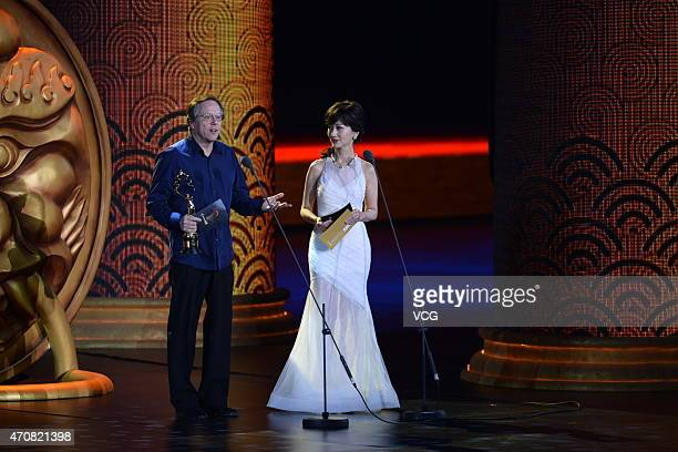 Fernando Meirelles jury member of the 5th Tiantan Award and actress Angie Chiu attend the closing ceremony of the 5th Beijing International Film...