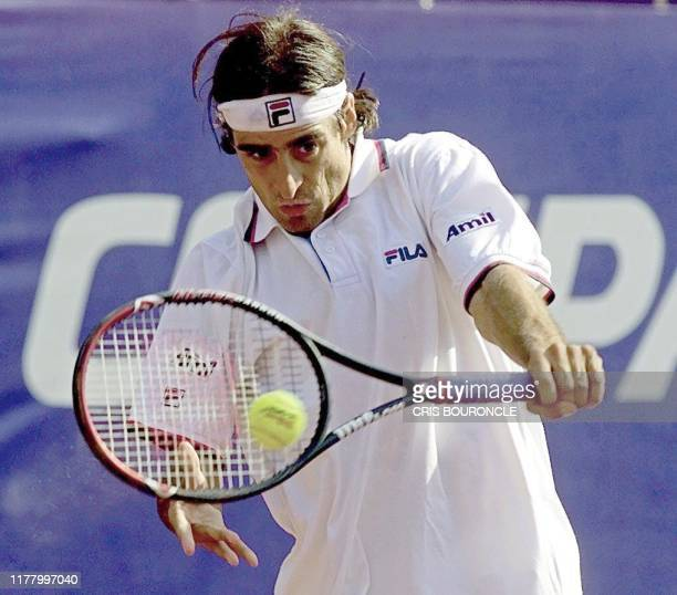 Fernando Meligeni of Brazil returns the ball to Chilean Nicolas Massu during the second day of the tournement in Santiago Chile 29 February 2000...
