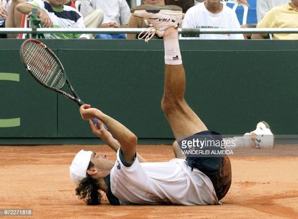 Fernando Meligeni of the Brazilian Davis Cup team falls during his match with Cedric Pioline of France at the Federal University in Florianopolis 04...