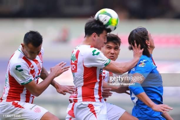 Fernando Meza of Necaxa heads the ball against Igor Lichnovsky of Cruz Azul during the 9th round match between Cruz Azul and Necaxa as part of the...