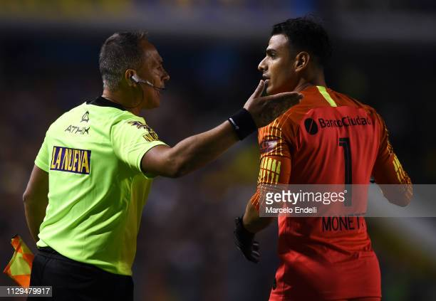 Fernando Monetti of San Lorenzo argues with assistant referee Ariel Scime after being sent off during a match between Boca Juniors and San Lorenzo as...