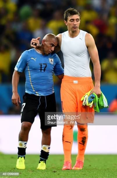 Fernando Muslera and Egidio Arevalo Rios of Uruguay react after the 02 defeat in the 2014 FIFA World Cup Brazil Round of 16 match between Colombia...