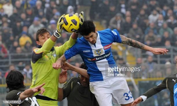 Fernando Muslera goalkeeper of Lazio catches the ball in the air ahead of Panagiochis Kone of Brescia during the Serie A match between Brescia Calcio...