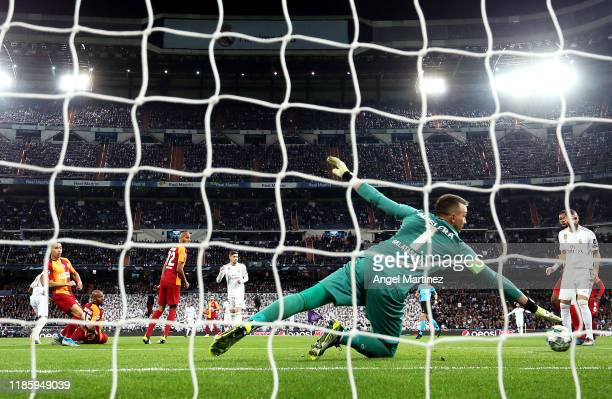 Fernando Muslera of Galatasaray fails to save a shot from Rodrygo of Real Madrid resulting in the first goal during the UEFA Champions League group A...