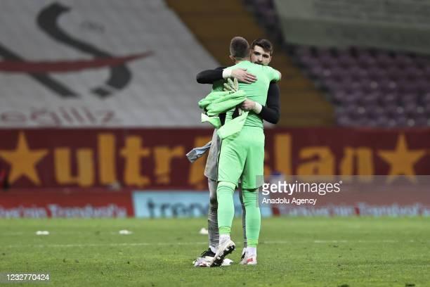 Fernando Muslera of Galatasaray hugs Ersin Destanoglu of Besiktas during the Turkish Super Lig week 40 football match between Galatasaray and...