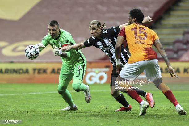 Fernando Muslera of Galatasaray in action against Domagoj Vida of Besiktas during the Turkish Super Lig week 40 football match between Galatasaray...
