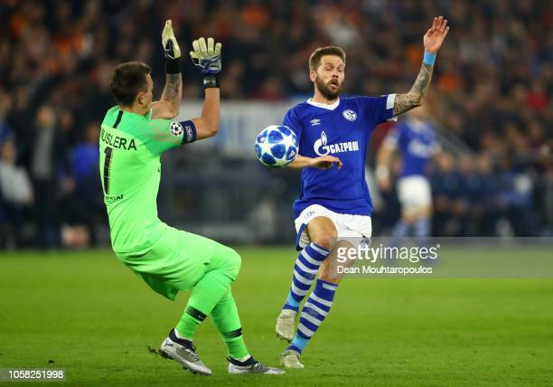 Fernando Muslera of Galatasaray saves a shot from Guido Burgstaller of FC Schalke 04 during the Group D match of the UEFA Champions League between FC...