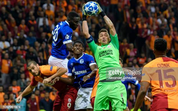 Fernando Muslera of Galatasaray saves the ball against Breel Embolo of Schalke during the Group D match of the UEFA Champions League between...