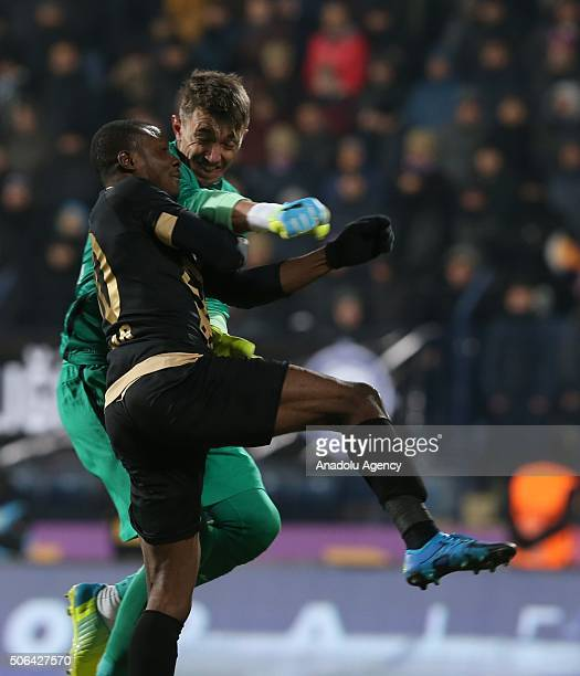 Fernando Muslera of Galatasaray vies with Umar Aminu of Osmanlispor during the Turkish Spor Toto Süper Lig football match between Osmanlispor and...