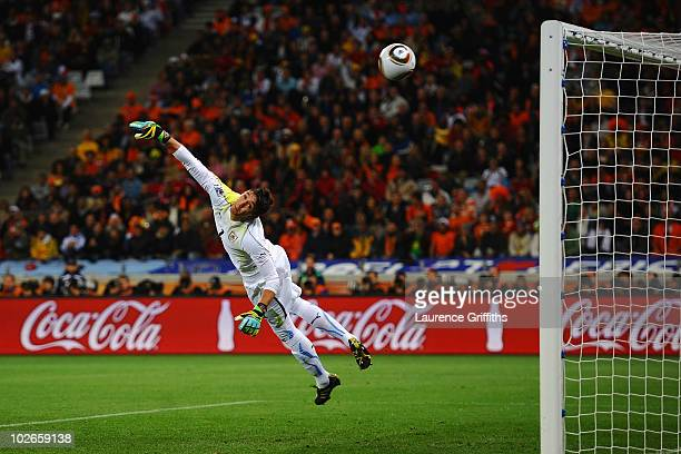 Fernando Muslera of Uruguay cannot save the shot by Giovanni Van Bronckhorst of the Netherlands as he scores the opening goal during the 2010 FIFA...