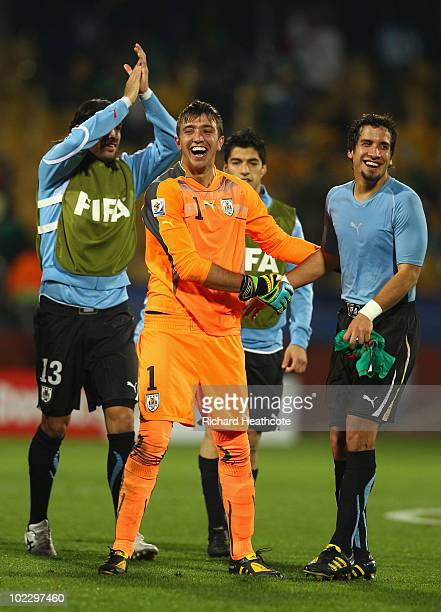 Fernando Muslera of Uruguay celebrates with team mates after victory in the 2010 FIFA World Cup South Africa Group A match between Mexico and Uruguay...
