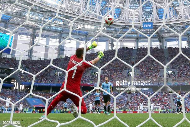 Fernando Muslera of Uruguay fumbles the ball as Antoine Griezmann of France scores his team's second goal during the 2018 FIFA World Cup Russia...
