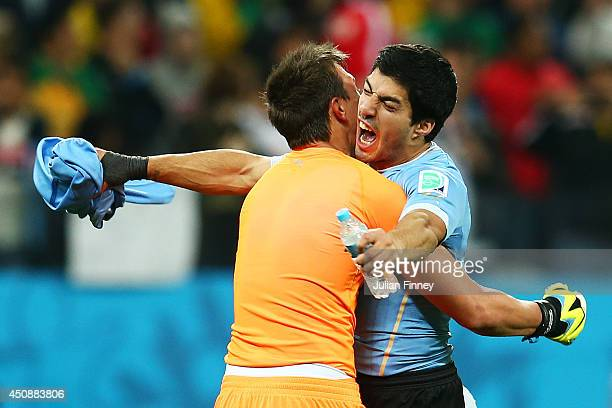 Fernando Muslera of Uruguay hugs Luis Suarez after defeating England 21 during the 2014 FIFA World Cup Brazil Group D match between Uruguay and...