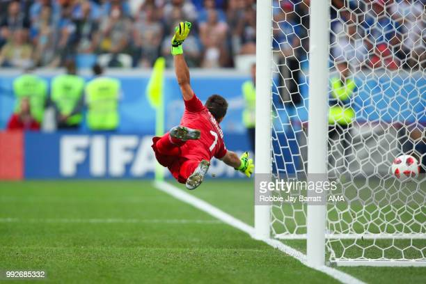 Fernando Muslera of Uruguay is unable to stop Raphael Varane of France scoring a goal to make it 01 during the 2018 FIFA World Cup Russia Quarter...