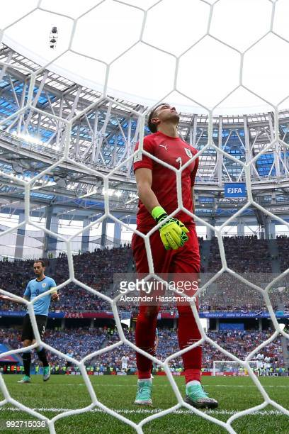 Fernando Muslera of Uruguay looks dejected after fumbling the ball and conceding from a Antoine Griezmann of France shot during the 2018 FIFA World...