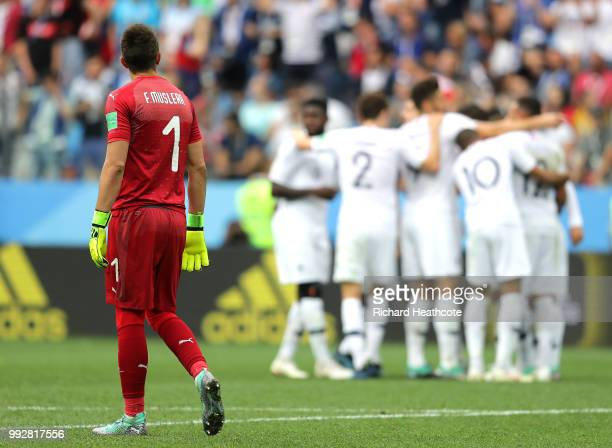 Fernando Muslera of Uruguay looks dejected as Antoine Griezmann of France celebrates with teammates after scoring his team's second goal during the...