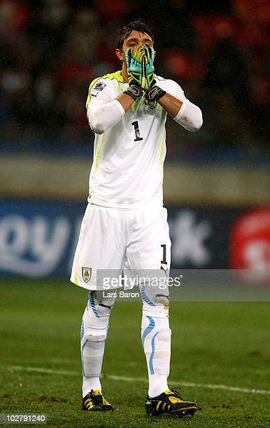 Fernando Muslera of Uruguay shows his dejection after Thomas Mueller of Germany scored the opening goal during the 2010 FIFA World Cup South Africa...