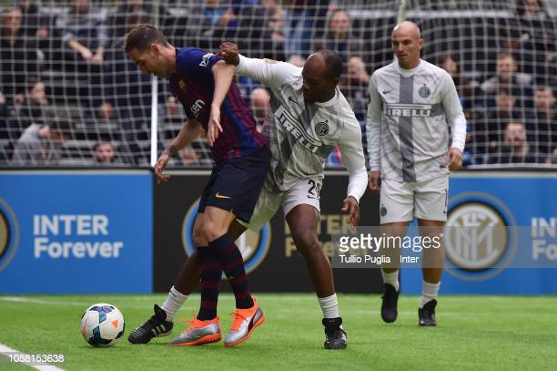 Fernando Navarro of Barcelona Legends is challanged by Suazo of Inter Forever during the match between FC Internazionale Legends and FC Barcelona...