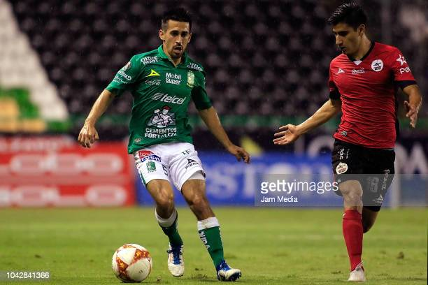 Fernando Navarro of Leon and Aldo Cruz of Lobos BUAP compete for the ball during the 10th round match between Leon and Lobos BUAP as part of the...