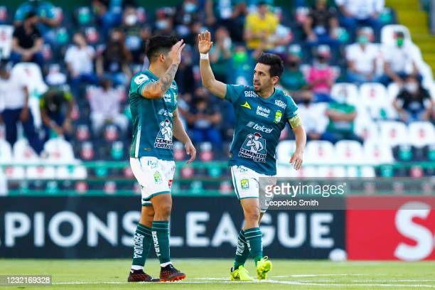 Fernando Navarro of Leon celebrates after scoring the first goal of his team with his teammate Victor Davila during a first leg match of round of...