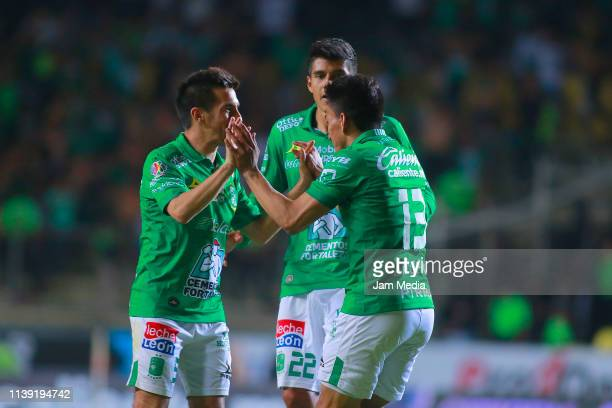 Fernando Navarro of Leon celebrates with teammate after scoring the first goal of his team during the 12th round match between Morelia and Leon as...