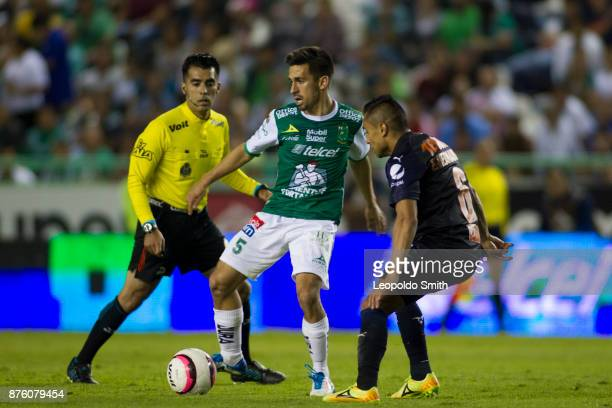 Fernando Navarro of Leon fights for the ball with Edwin Hernandez of Chivas during the 17th round match between Leon and Chivas as part of the Torneo...