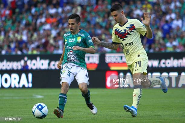 Fernando Navarro of Leon fights for the ball with Nicolas Benedetti of America during the 2nd round match between Leon and America as part of the...