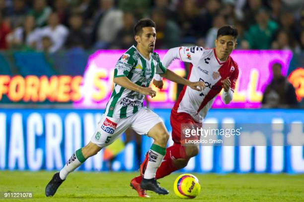 Fernando Navarro of Leon figths for the ball with Dieter Villalpando during the 4th round match between Leon and Necaxa as part of the Torneo...