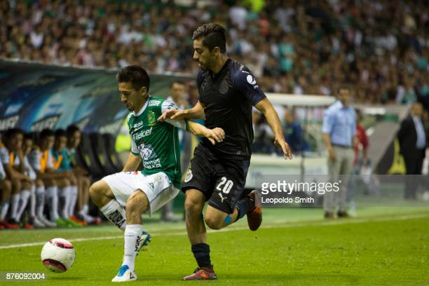 Fernando Navarro of Leon figths for the ball with Rodolfo Pizarro of Chivas during the 17th round match between Leon and Chivas as part of the Torneo...