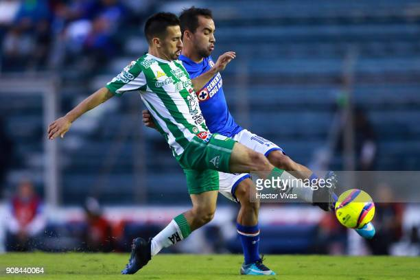 Fernando Navarro of Leon struggles for the ball with Adrian Aldrete of Cruz Azul during the 3rd round match between Cruz Azul and Leon as part of the...
