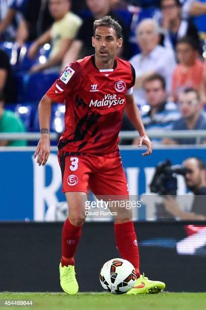 Fernando Navarro of Sevilla FC runs with the ball during the La Liga Match between RCD Espanyol and Sevilla FC at CornellaEl Prat Stadium on August...